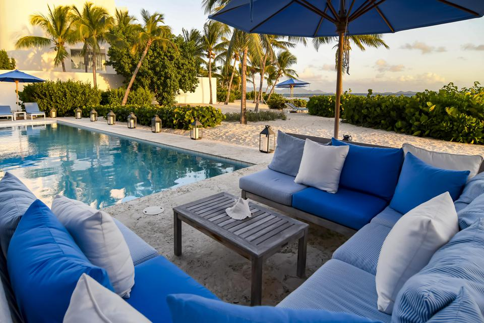A pool and lounge chairs at Altamer Resort Anguilla.