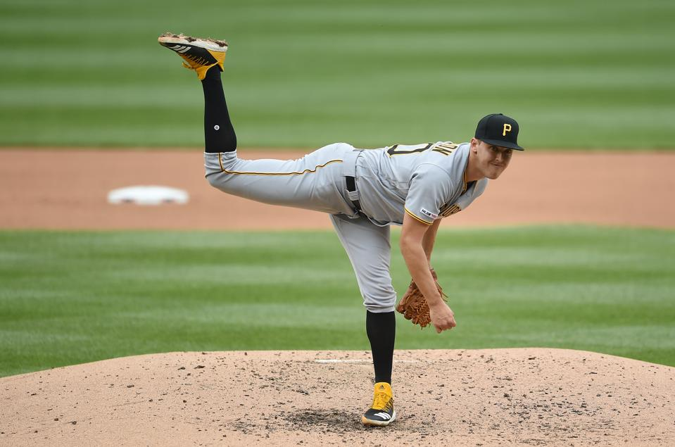 Right-handed pitcher Jameson Taillon throwing towards home plate.