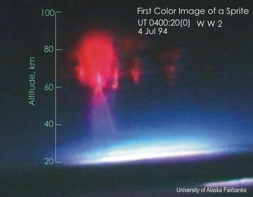 The first color photograph of a red sprite during a transient lightning event.