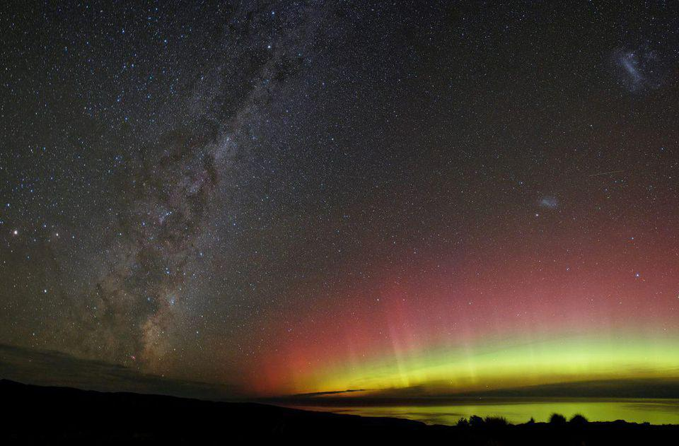 A multicolored aurora, shown with the Milky Way over New Zealand.