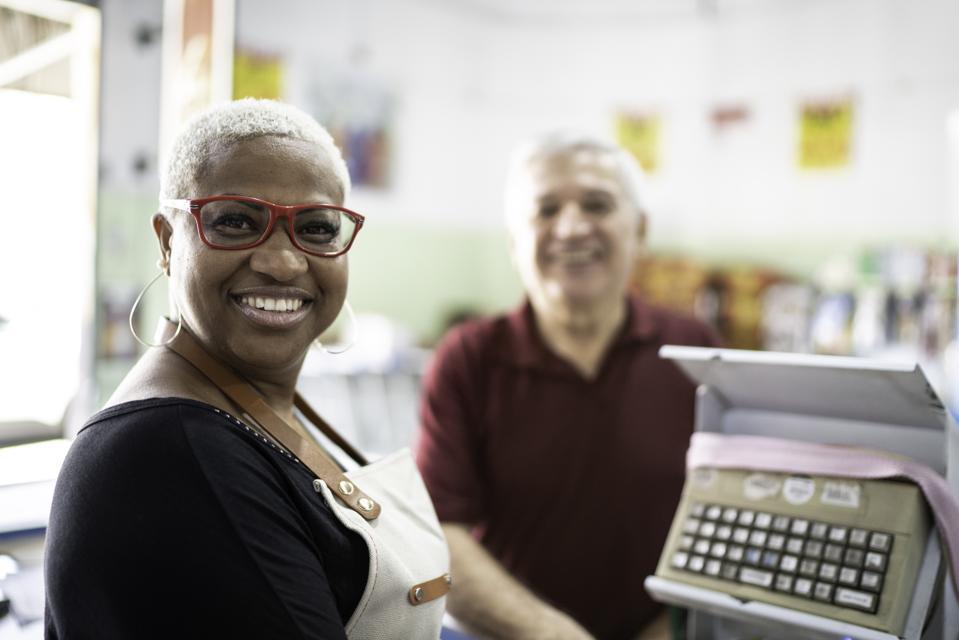 Portrait of smiling mature cashier at wholesale