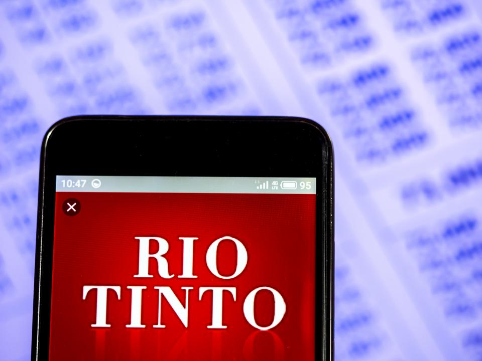 In this photo illustration a Rio Tinto plc company logo seen...
