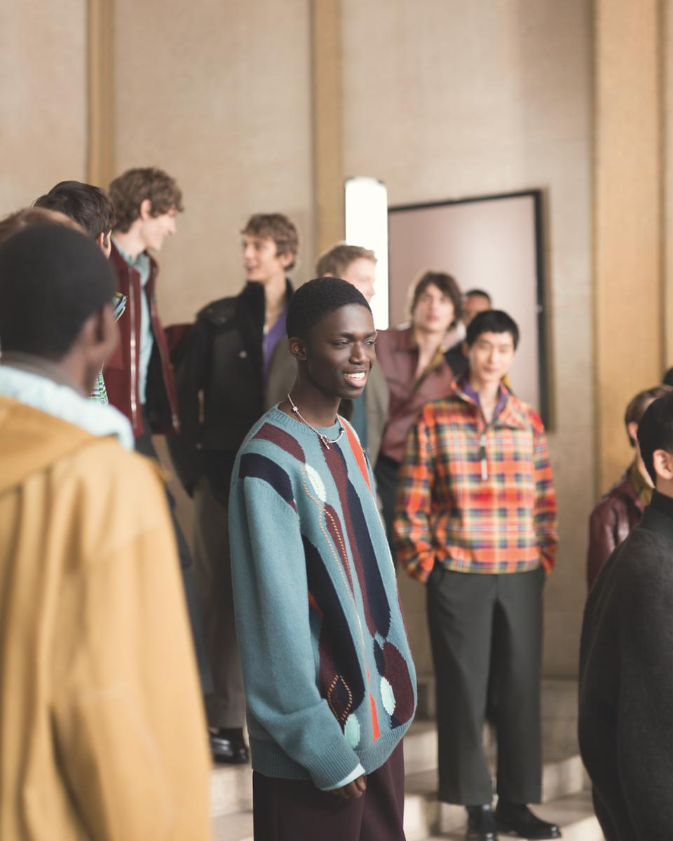 a group of male models intermingle as part of the Hermés Fall 2021 collection film.