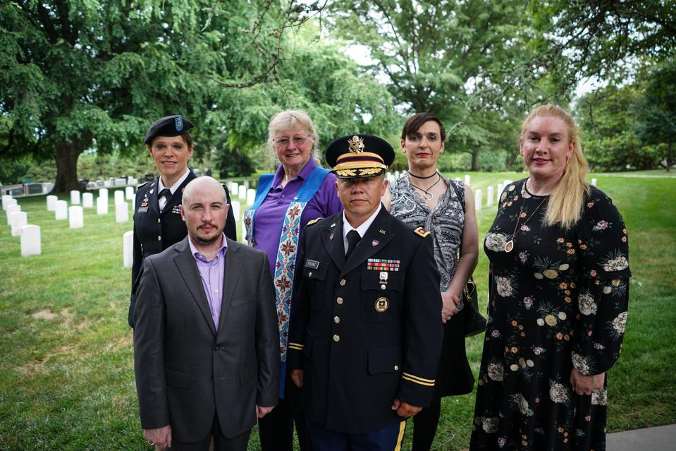US-MILITARY-TRANSGENDER-POLITICS Retired Army lieutenant colonel Ann Murdoch; Transgender American Veterans Association Vice President Gene Silvestri; Yvonne Cook-Riley; retired Army major and Transgender American Veterans Association President Evan Young; petty officer first class Alice Ashton; and retired Air Force major Nella Ludlow in Arlington National Cemetery