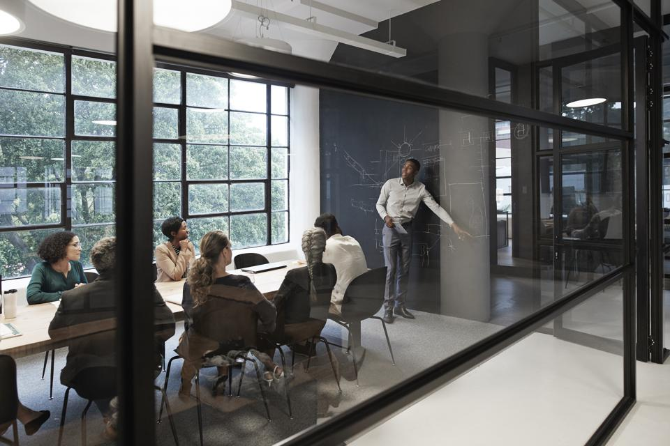 Businessman with coworkers in conference room