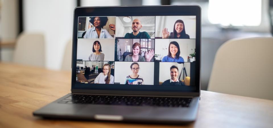 Colleagues having a work meeting through a video call