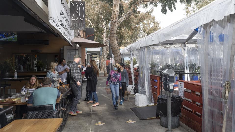 Customers dine outside in Laguna Beach, CA