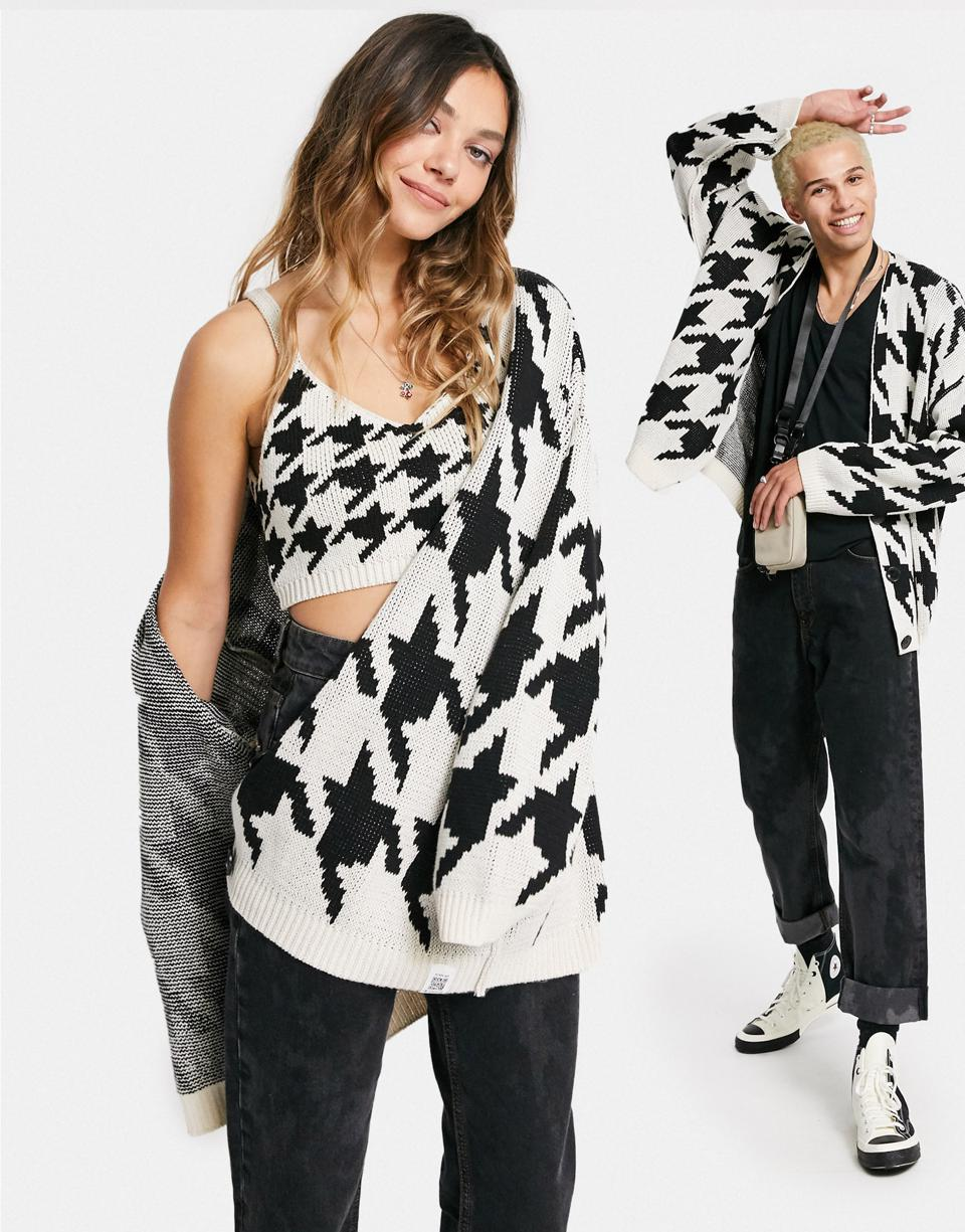 Graphic black and white apparel worn by a woman and man from Asos, which targets fashion-focused 20-somethings, in negotiating to buy Topshop and Topman, among other brands from the U.K.'s Arcadia Group.