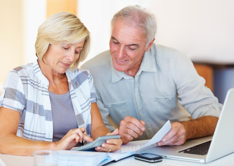 Senior couple happy about their budgeting