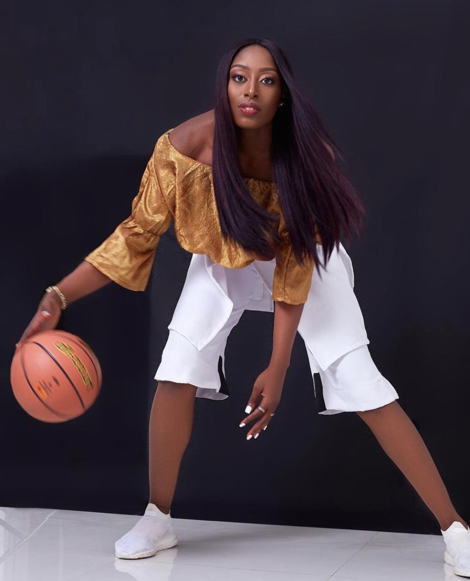 Chiney Ogwumike holding a basketball.