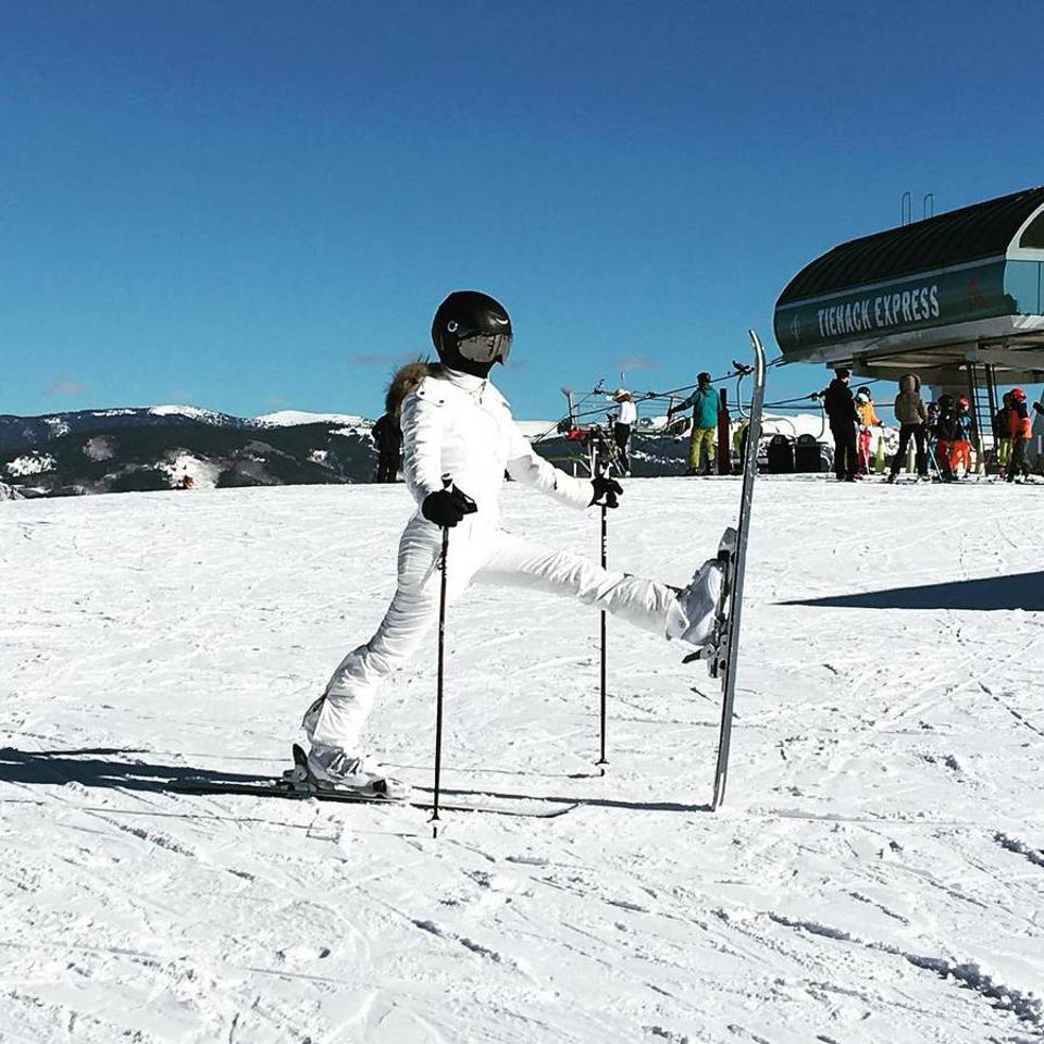 Kourtney Kardashian in an all-white ski look.
