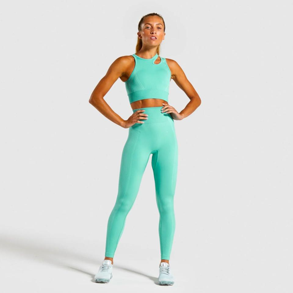 Athletic woman wearing sea foam green leggings and matching sleeveless tank top