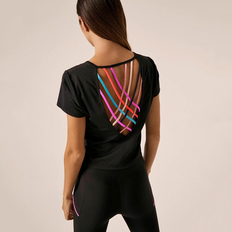 Back of black T-shirt with multi-color criss-cross ribbons across back cut out