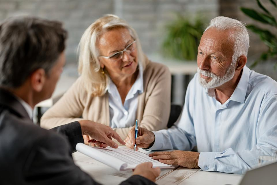 Elderly couple developing their estate plan.