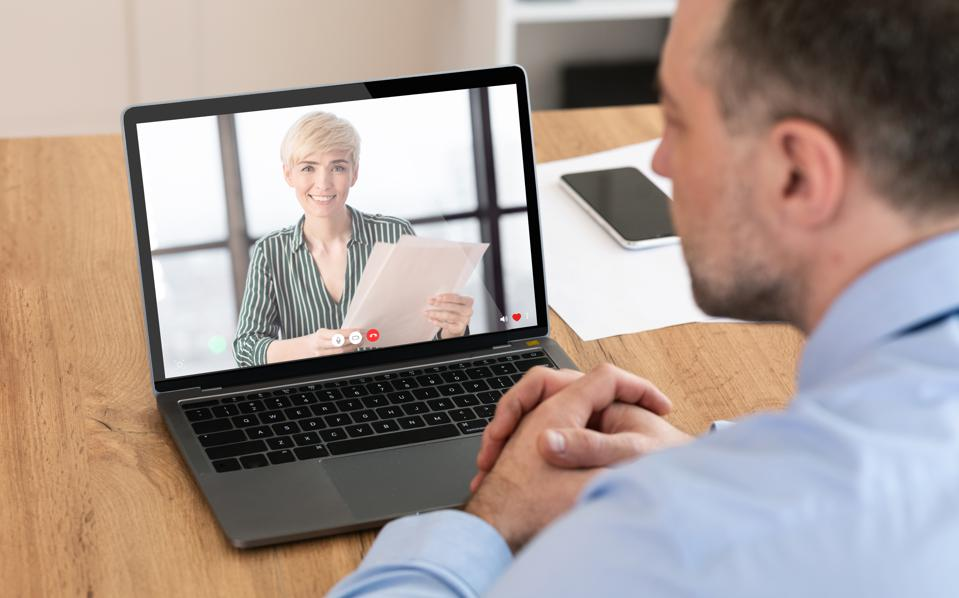 Unrecognizable man having a business videocall, using laptop