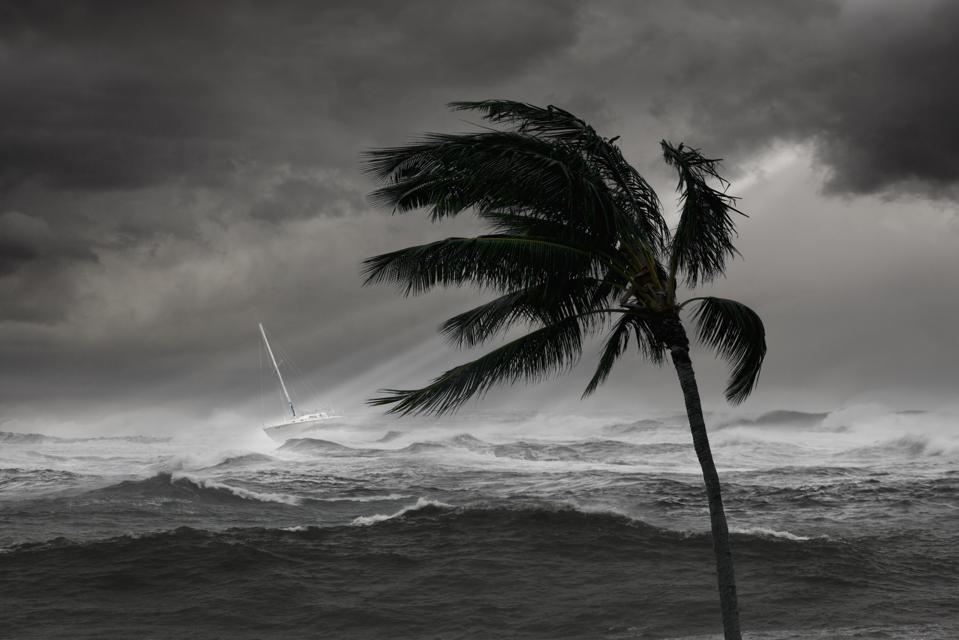 Boat on ocean in tropical storm