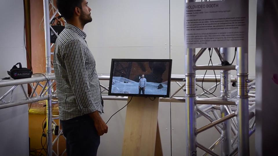A participant inside Imverse's holographic booth