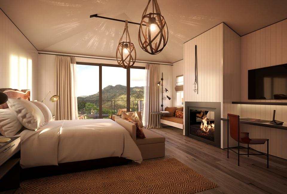 The interior of a luxury hotel room at the Four Seasons Napa Valley overlooks vineyards