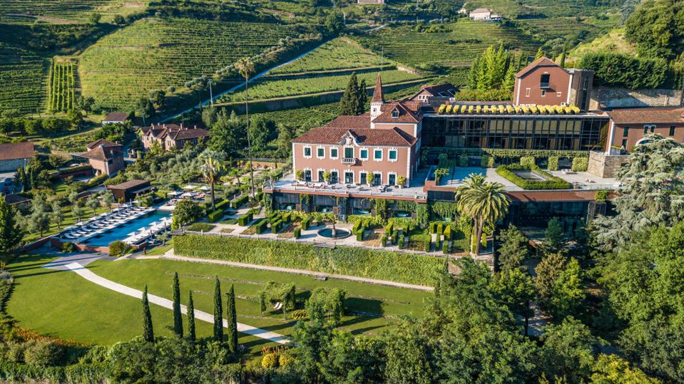 An aerial view of the resort buildings, swimming pool and vineyards at Six Senses