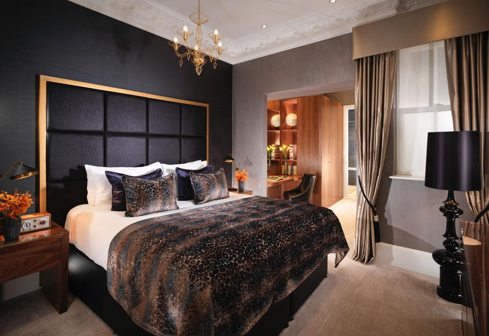 The bedrooms at Flemings Mayfair hotel in London are dark and comfortable