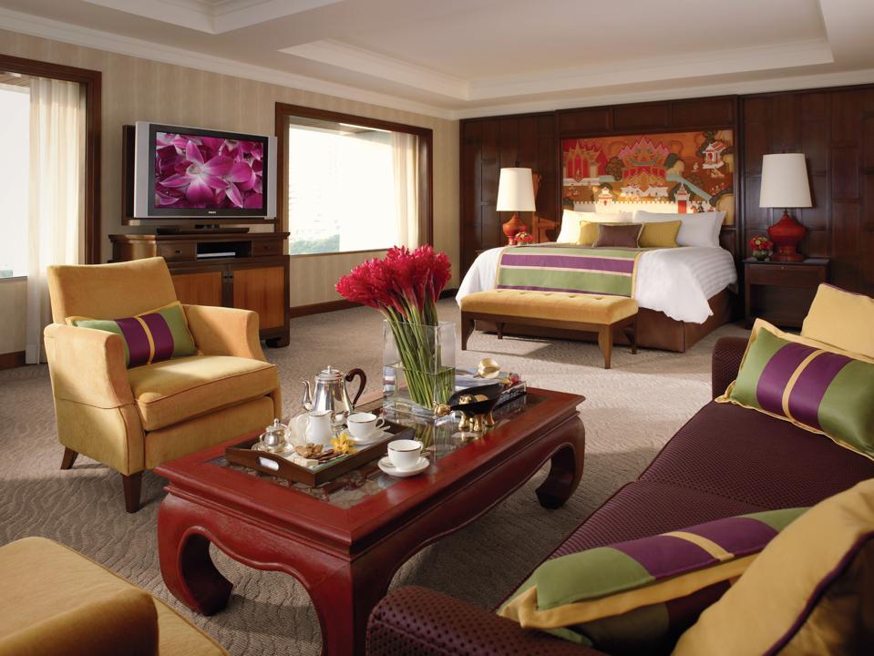 Rooms at the Anantara Siam Bangkok hotel in Thailand are bright and colorful.