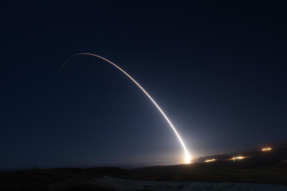 Image of ballistic trajectory of a strategic missile against the night sky.