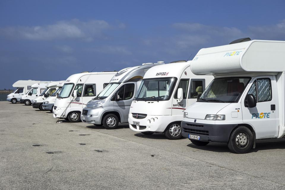 Row of motorhomes parked in car park