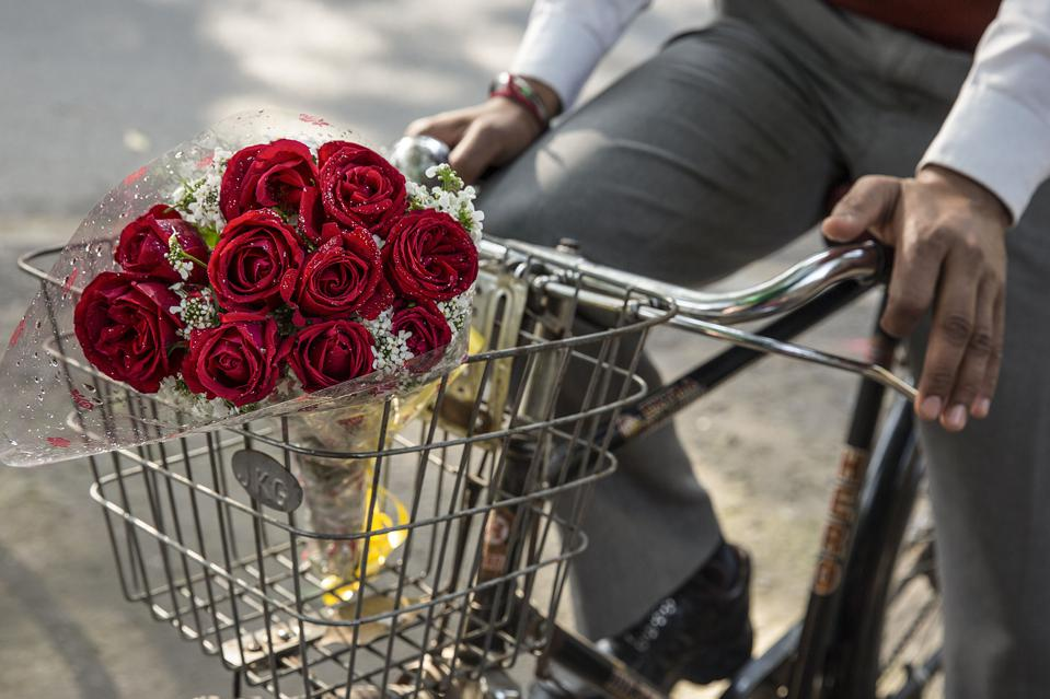 Close up of roses in a bicycle basket