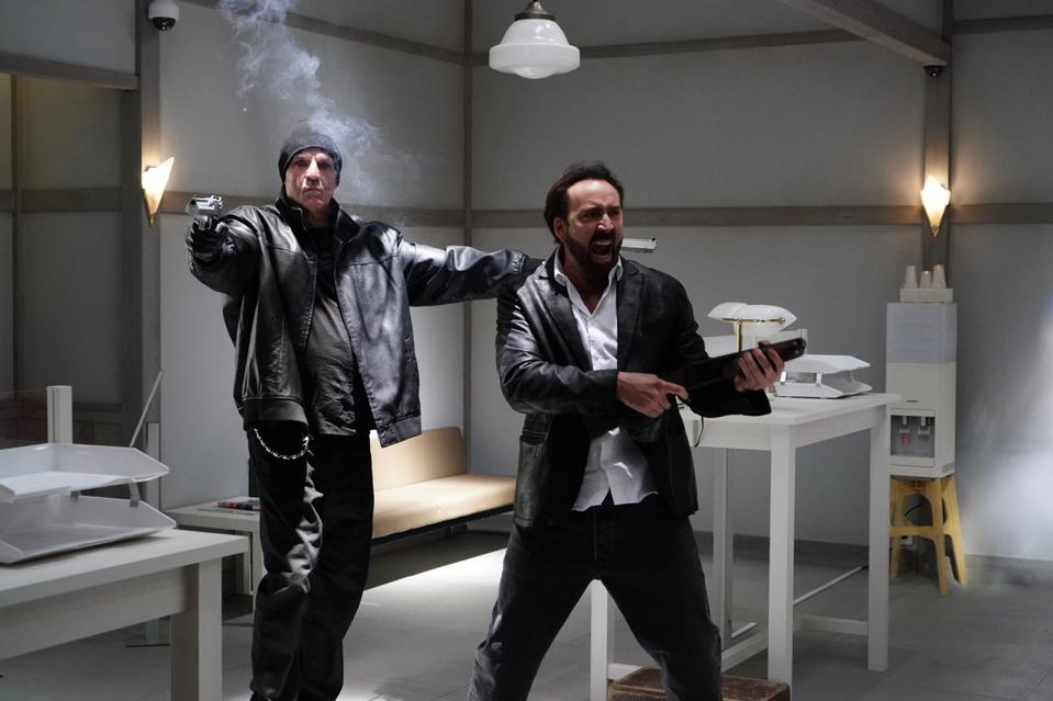 Nicolas Cage and another actor in scene from ″Prisoners of the Ghostland″