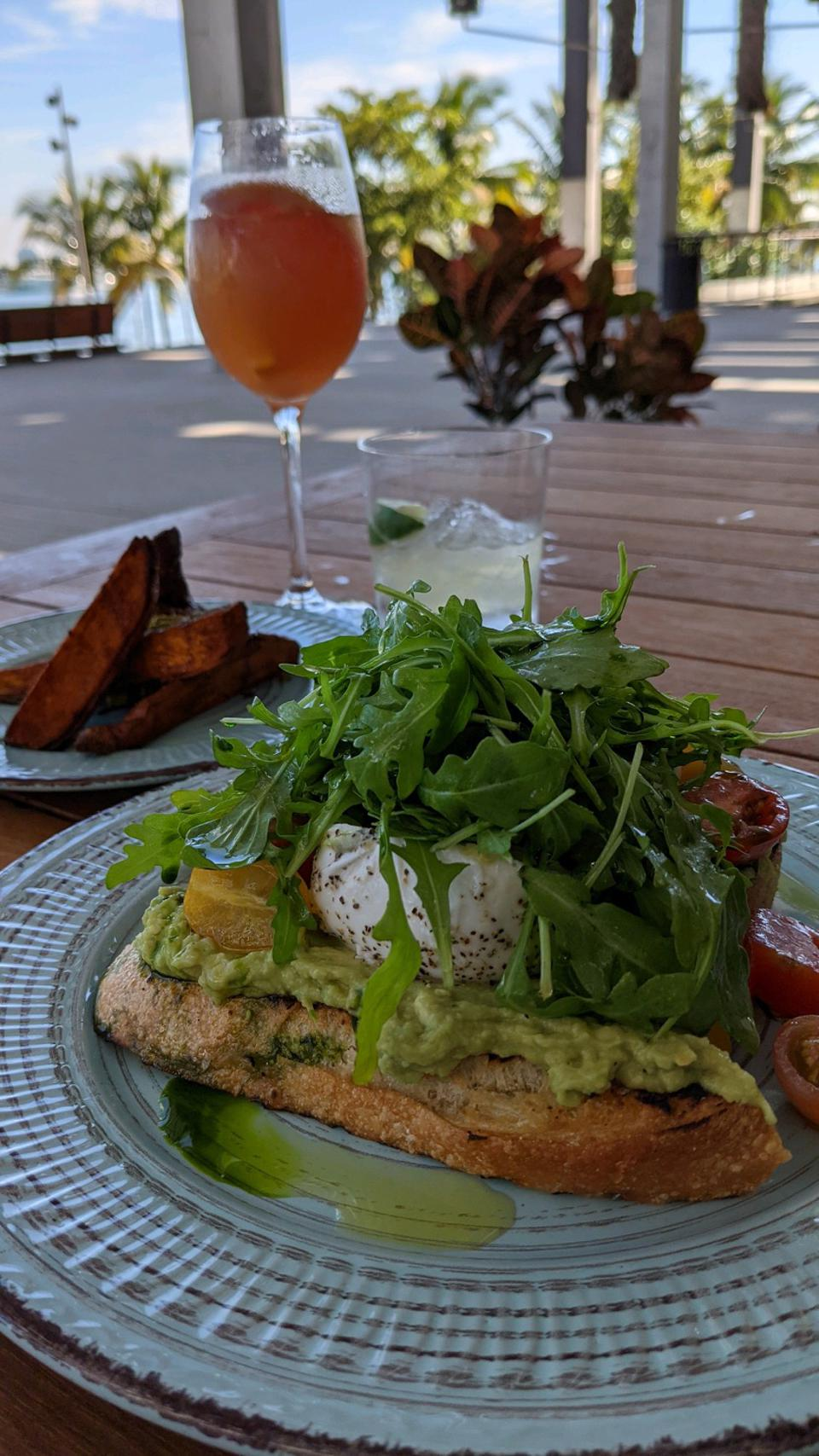 Cocktails, avocado toast and potato wedges at PAMM Miami's Verde restaurant.
