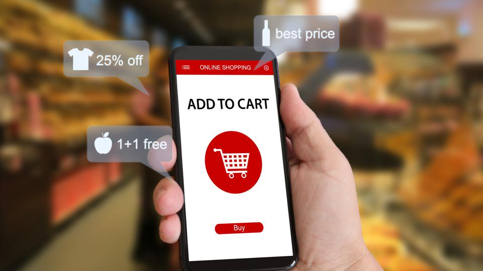 A hand holidng a mobile phone showing an mobile E-commerce shopping experience enhanced by artificial intelligence.
