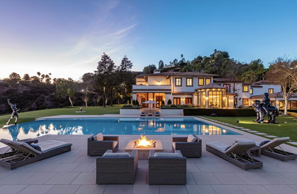 A pool with a large pool deck.