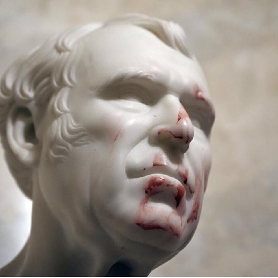 Photo of sculpture of former US President Zachary Taylor in the United States Capitol Building splattered with human blood following the seditious insurrection by Trump supporters on Jan 6, 2021. Photo by Katherine Frey for The Washington Post.