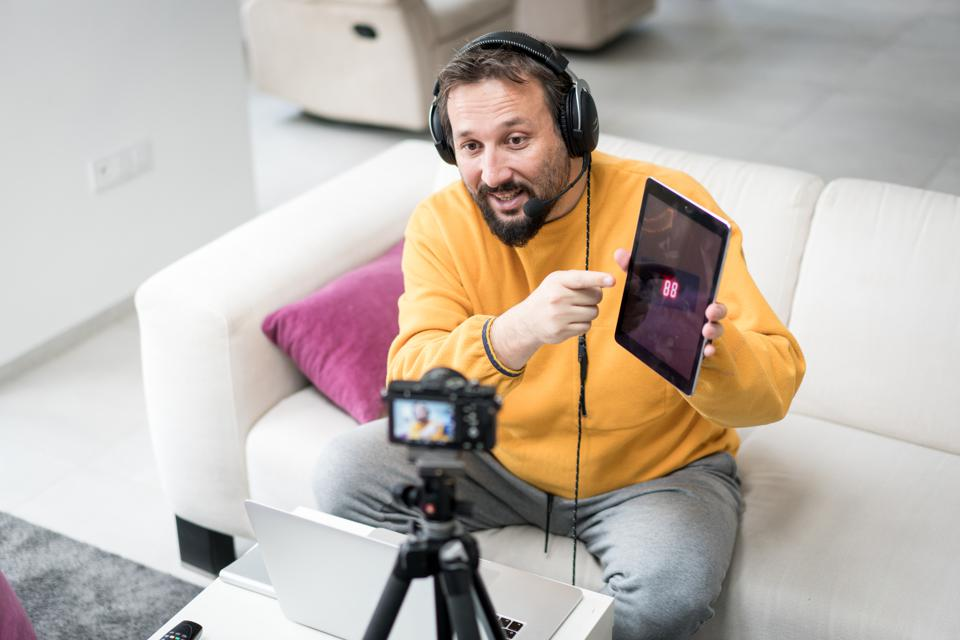 Male vlogger making content on camera
