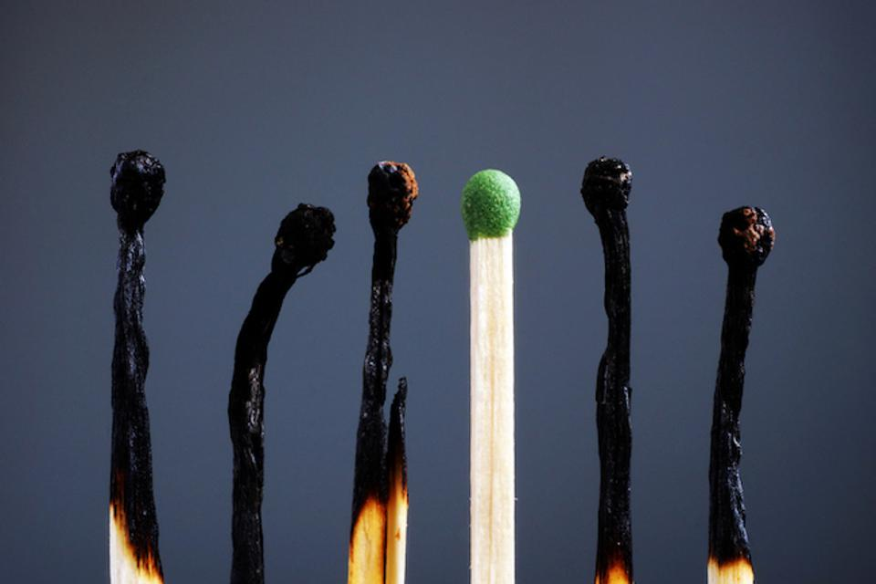 Line of burnt matches and one brand new. Video meeting fatigue is accelerating burnout