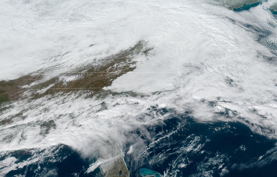 A visible satellite image of clouds over much of the Mid-Atlantic on January 26, 2021.