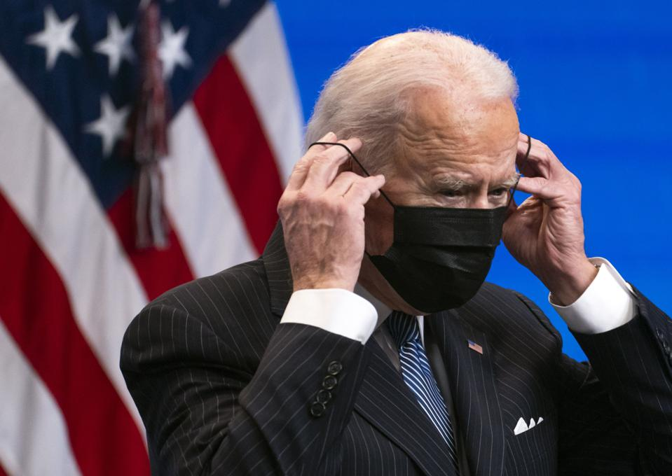 President Joe Biden dons a protective mask Monday in Washington during an executive signing event to strengthen American manufacturing. (Photographer: Kevin Dietsch/UPI/Bloomberg)