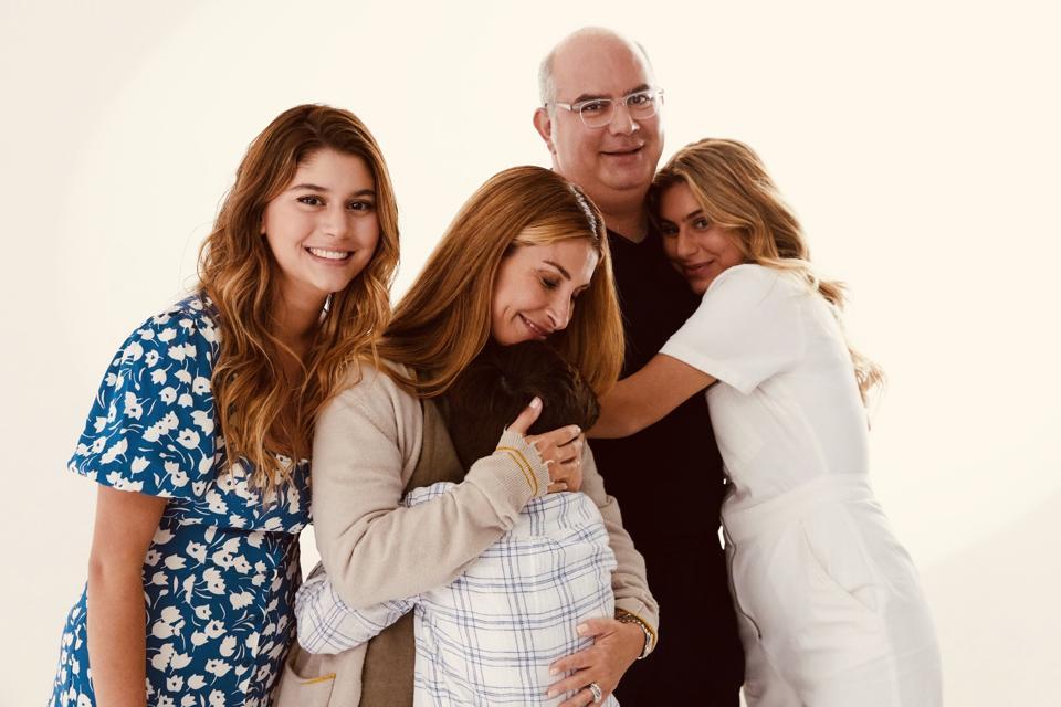 Dr. Shawn Nasseri and Dr. Bita Nasseri smile with their three children.