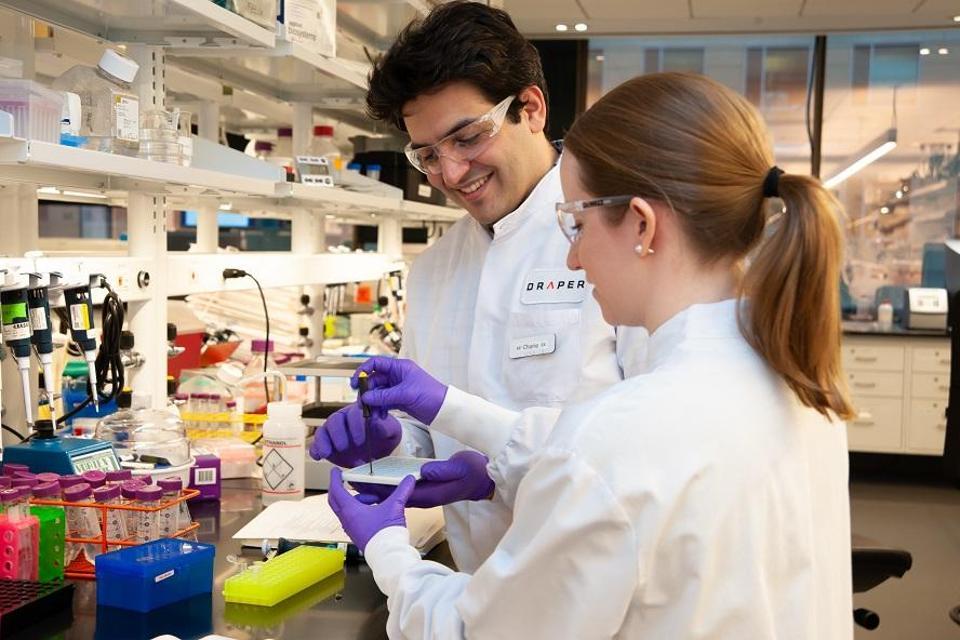 Draper engineers configure a device for detecting bioengineered organisms.