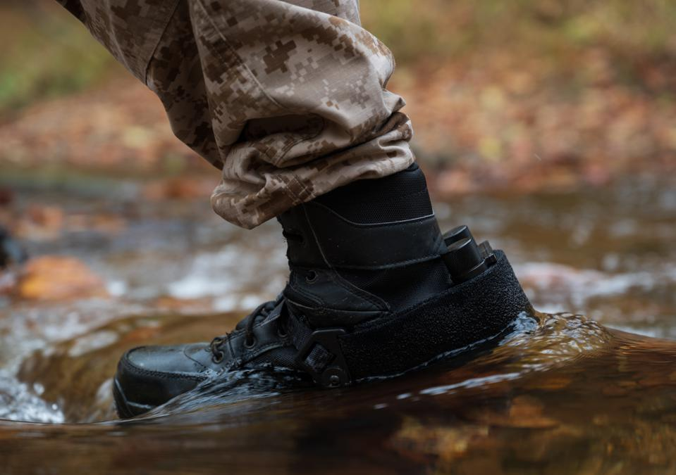 A small WarLoc inertial navigation system strapped to a soldier's boot.