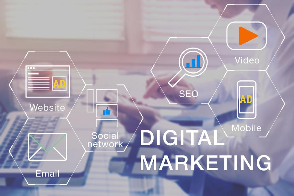 Digital Marketing manager working on social media network, internet website, mobile and email advertisement communication campaign with SEO and pay per click return on investment strategy