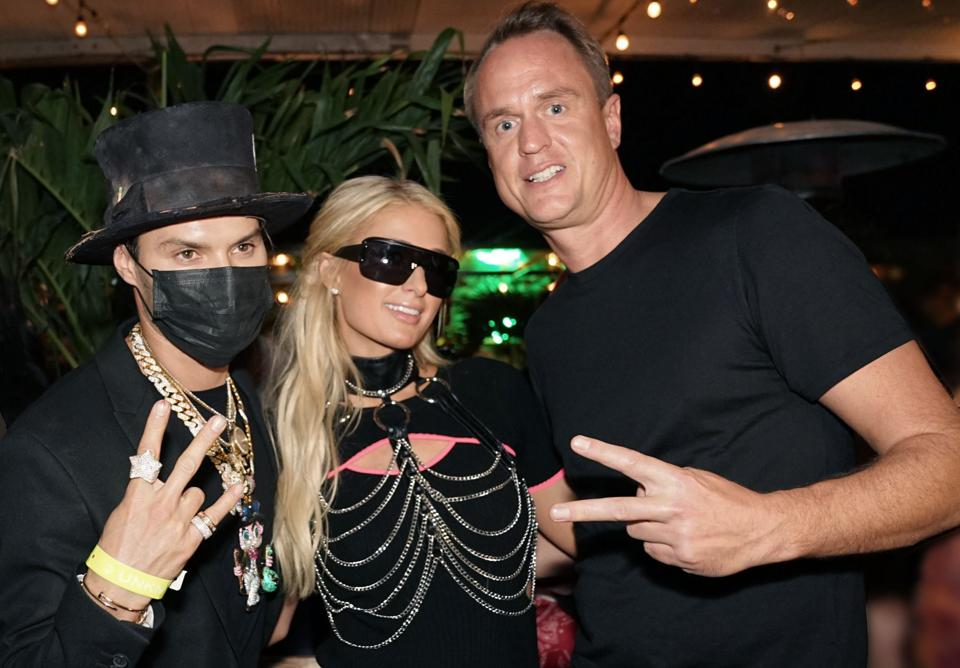 Posth with Paris Hilton and Alec Monopoly.