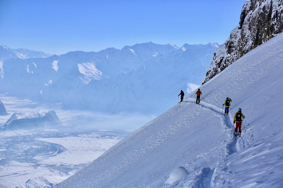Hiking through the deep powder with Cookson Adventures.