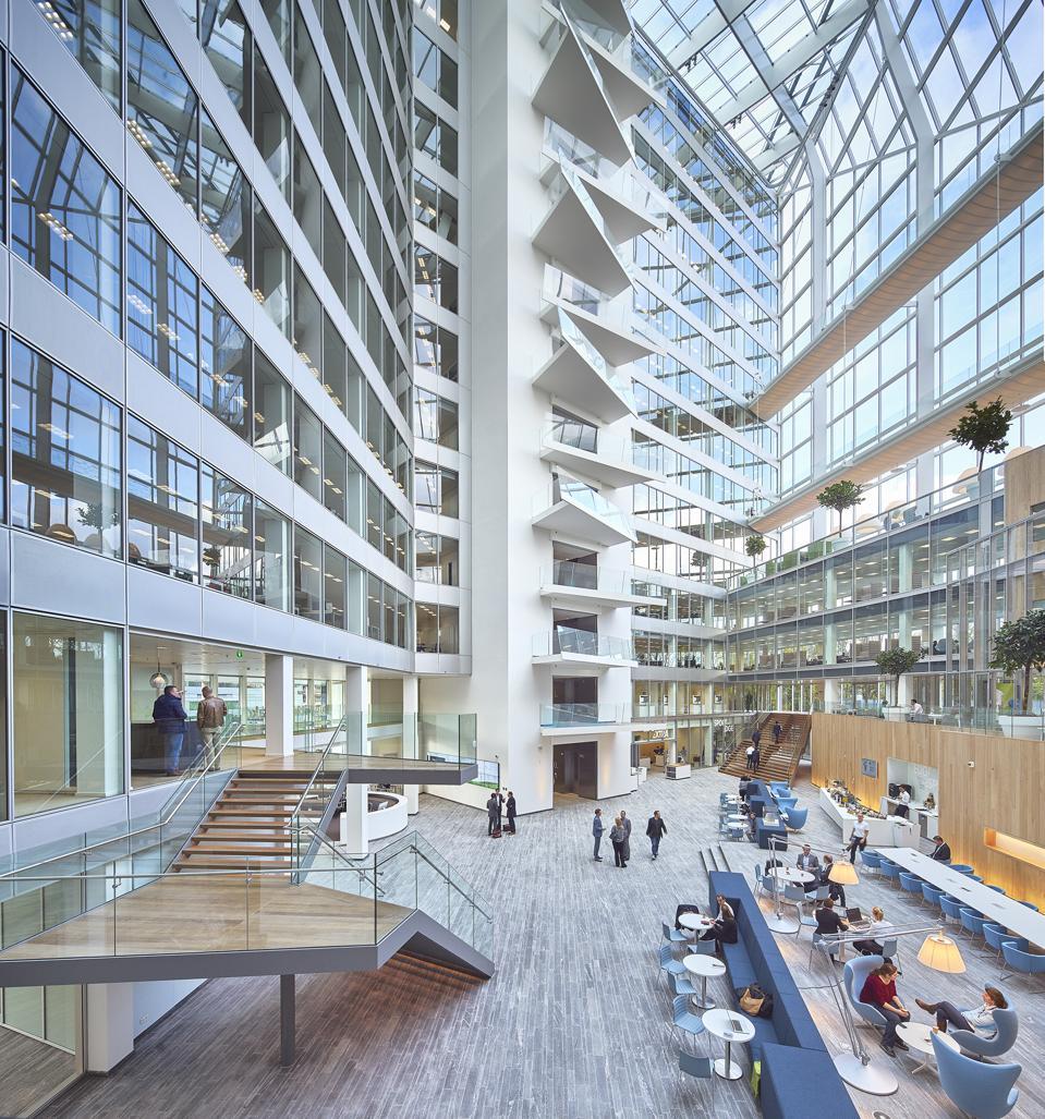 The sunlit atrium of The Edge smart building in Amsterdam.