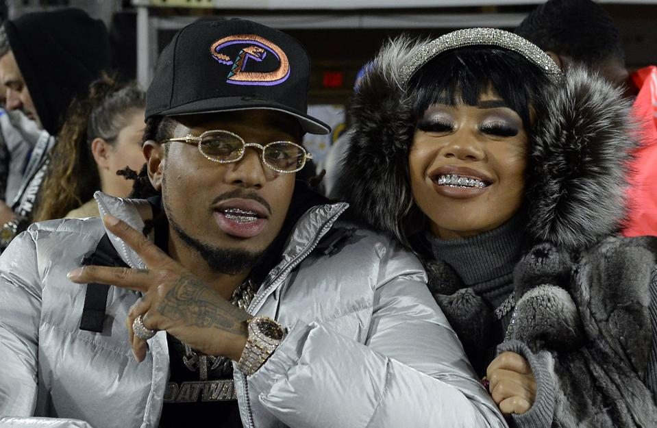 LOS ANGELES, CA - NOVEMBER 25: Rapper Quavo of Migos and Saweetie attend a football game between Baltimore Ravens and Los Angeles Rams at Los Angeles Memorial Coliseum on November 25, 2019 in Los Angeles, California.