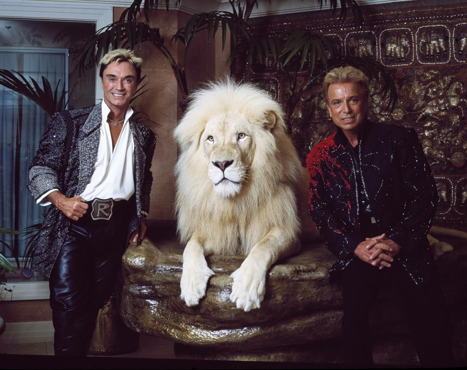 Las Vegas superstar illusionists Siegfried (right) and Roy (and a large feline friend) at their MIra