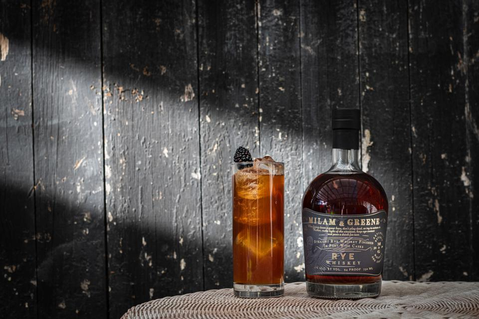 Bottle of Milam & Greene Port Cask-Finished Rye with highball