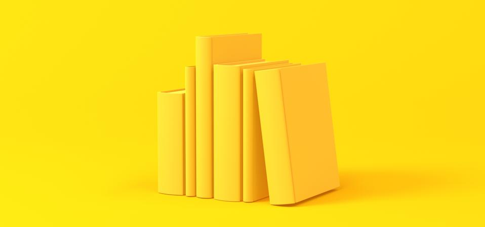 Books isolated over a yellow background. Minimalist concept.