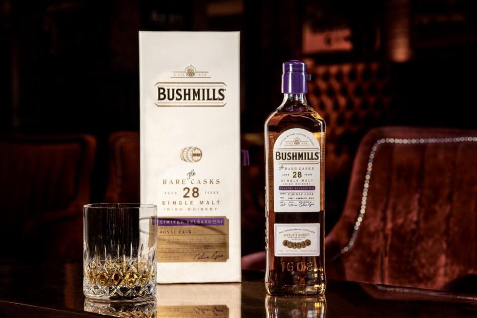 Bottle of Bushmills 28 Year Cognac Cask-Finished Single Malt Irish Whiskey with glass