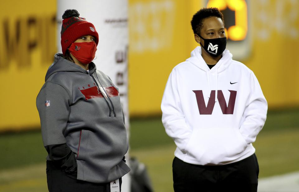 Tampa Bay Buccaneers defensive line coach Lori Locust and Washington Football Team coaching intern Jennifer King in action before an NFL wild-card playoff football game against the Tampa Bay Buccaneers, Saturday, Jan. 9, 2021 in Landover, Md. (AP Photo/Daniel Kucin Jr.)